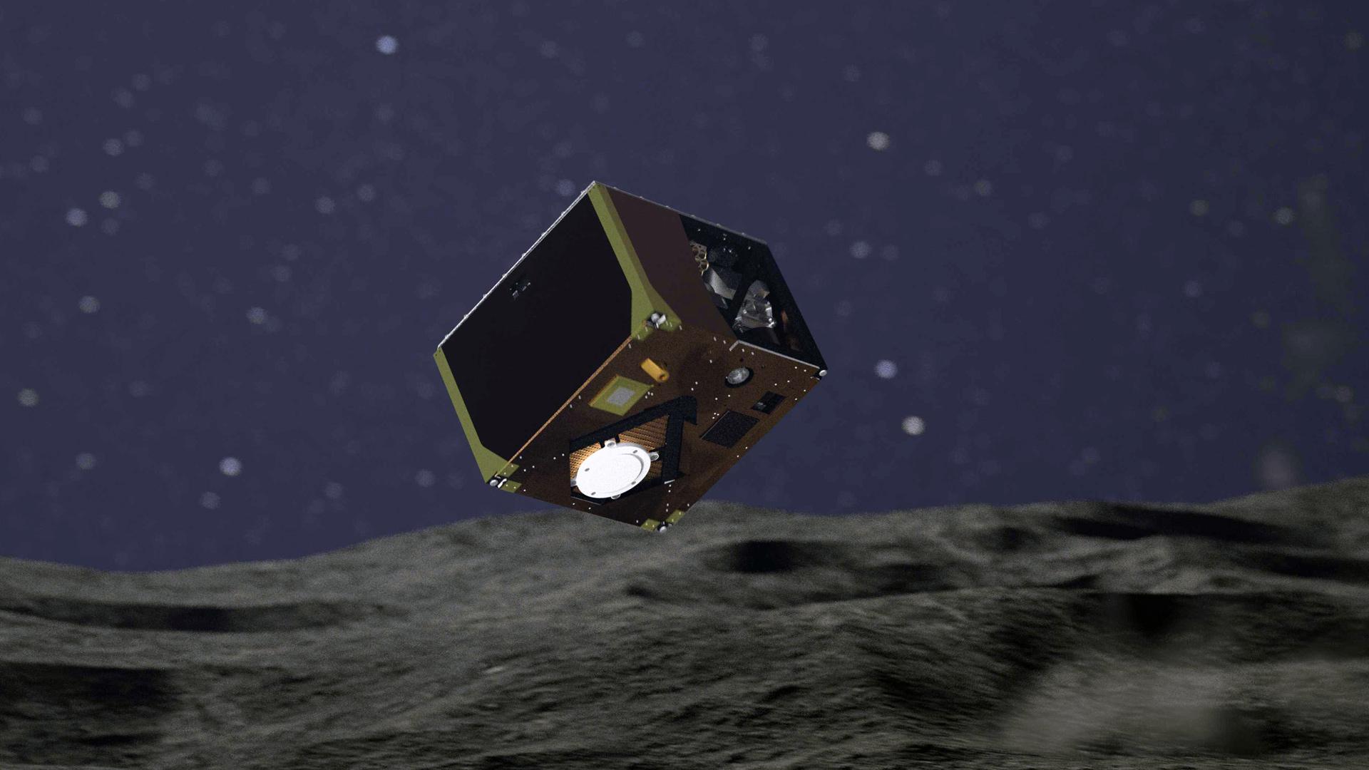 Piirros näyttää MASCOT-laskeutujan lähellä asteroidin pintaa